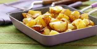 Fried potatoes in a frying pan Royalty Free Stock Photos