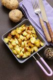 Fried potatoes in a frying pan Stock Image