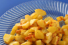 Fried potatoes on glass plate Royalty Free Stock Photography