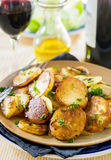 Fried potatoes with goose duck grease and parsley Royalty Free Stock Image