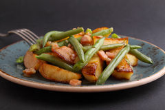 Fried potatoes with green beans Stock Photo