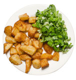 Fried potatoes and green salad. Stock Image