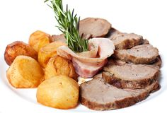 Fried potatoes and ham. Gold potatoes and juicy meat Stock Image