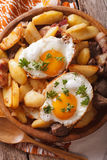 Fried potatoes with meat, bacon and eggs close-up vertical top Royalty Free Stock Photos