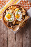 Fried potatoes with meat and eggs in a bowl. vertical top view Stock Photography