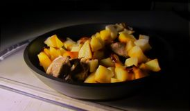 Fried potatoes with meat. A pan with fried potatoes and meat Royalty Free Stock Images