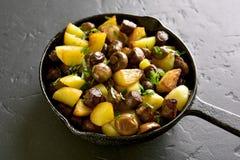 Fried potatoes with mushroom and sausage Stock Image