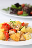 Fried potatoes with mushrooms and cherry tomatoes Stock Image