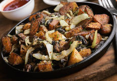 Fried potatoes with mushrooms Stock Image