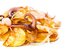 Fried potatoes with octopus. White background. macro view Stock Image