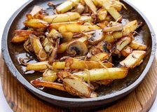 Fried potatoes with onions and mushrooms. stock image