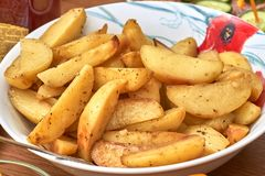 Fried Potatoes in the Oven. Plate of Idaho Hot Chips royalty free stock images