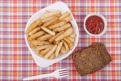 Fried potatoes in a plate. Stock Photo
