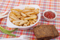 Fried potatoes in a plate. Stock Image