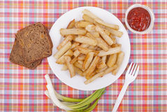 Fried potatoes in a plate. Royalty Free Stock Image