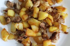 Fried potatoes with pork meat royalty free stock images