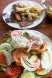 Fried potatoes, salad and fish - hake Stock Photo