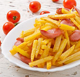 Fried potatoes with sausage Royalty Free Stock Photography