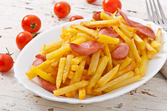 Fried potatoes with sausage Royalty Free Stock Images