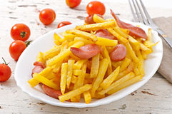 Fried potatoes with sausage Royalty Free Stock Image