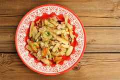 Fried potatoes with scallion in red plate topview copyspace Royalty Free Stock Photos