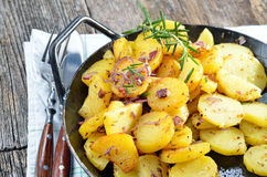 Fried potatoes in a serving pan Royalty Free Stock Photo