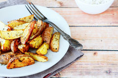 Fried potatoes with spices Royalty Free Stock Photo