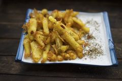 Fried potatoes with spices. French fries fried in vegetable oil and sprinkled with spices stock photo