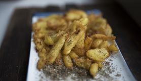 Fried potatoes with spices. French fries fried in vegetable oil and sprinkled with spices stock images