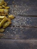 Fried potatoes with spices. French fries fried in vegetable oil and sprinkled with spices stock image
