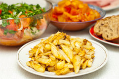 Fried potatoes on a table Stock Photos