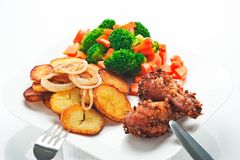 Fried potatoes with vegetables and chicken Royalty Free Stock Photos