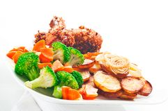 Fried potatoes with vegetables and chicken Stock Photo