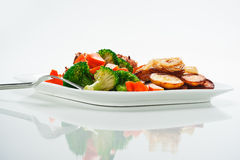 Fried potatoes with vegetables and chicken Royalty Free Stock Image