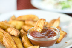 Fried potatos. In white plate with ketchup cup Royalty Free Stock Image