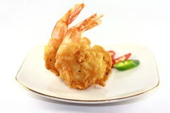 Fried prawn. Fried tiger prawns served on white plate with chilli garnish Royalty Free Stock Photos