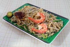 Fried Prawn Noodles. Hokkein (Chinese) Dish of Fried Noodles with Prawns and squid royalty free stock photos