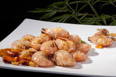 Fried prawns. Fried shrimp on a white china plate stock images