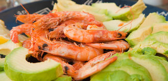 Fried prawns and avocado Stock Photos