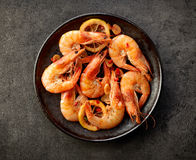 Fried prawns on black plate Royalty Free Stock Photo