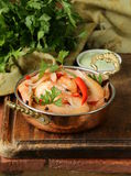 Fried prawns with chilli in a copper pan Royalty Free Stock Photos