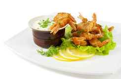 Fried prawns in coconut breading with dipping sauce Stock Images