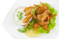 Fried prawns in coconut breading with dipping sauce Royalty Free Stock Photo