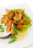 Fried prawns in coconut breading with dipping sauce Royalty Free Stock Images