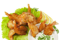 Fried prawns in coconut breading with dipping sauce on white iso Stock Photos