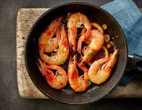 Fried prawns on cooking pan Stock Photos