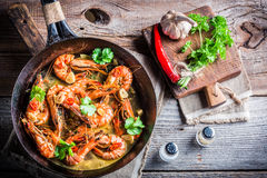 Fried prawns with garlic and red peppers Royalty Free Stock Images