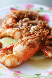 Fried prawns with garlic and spices Royalty Free Stock Images