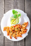 Fried Prawns with lemon. Served on a wooden surface Royalty Free Stock Photo