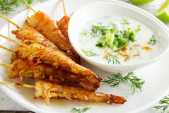 Fried prawns with sauce of yogurt Stock Images